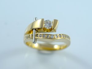 Custom Omori Ring Design with round diamond.