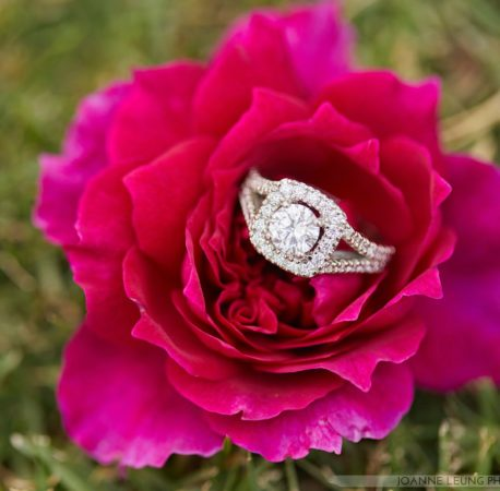 halo engagement ring on flower