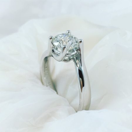 solitaire engagement ring with white background